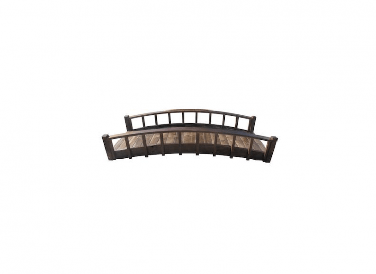 An eight-foot Japanese Wood Garden Moon Bridge with Arched Railings, made of fir and treated, has a one-year limited warranty; \$93\1.\19 from Home Depot.