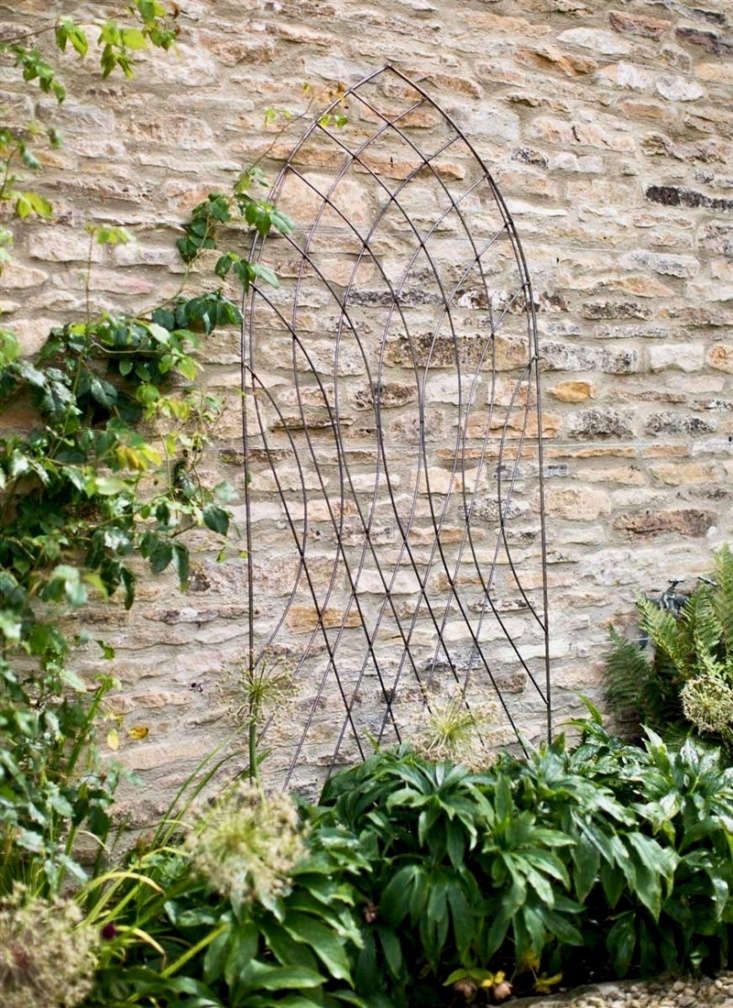 A raw metal Barrington Arch Trellis comes with spikes to secure it to the ground; £55 from Garden Trading.