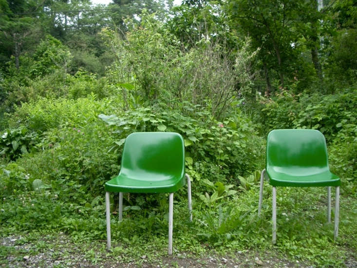 Chosen to disappear into the background, two green chairs serve as a mirror for the surrounding foliage at Karuizawa Town Botanical Garden in Japan. Photograph by Akaitori via Flickr.