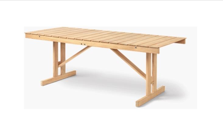 Designed by Børge Mogensen, the FSC-certified teak Deck Folding Table can be folded flat; $loading=