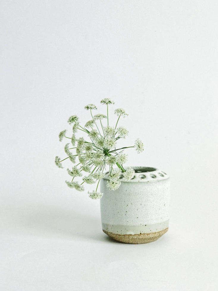 A handmade Ceramic Flower Frog/Vase is glazed in white; $45 from Lemonglaze via Etsy.