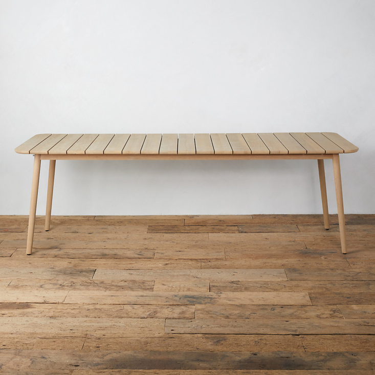 The Grove Teak Dining Table is $