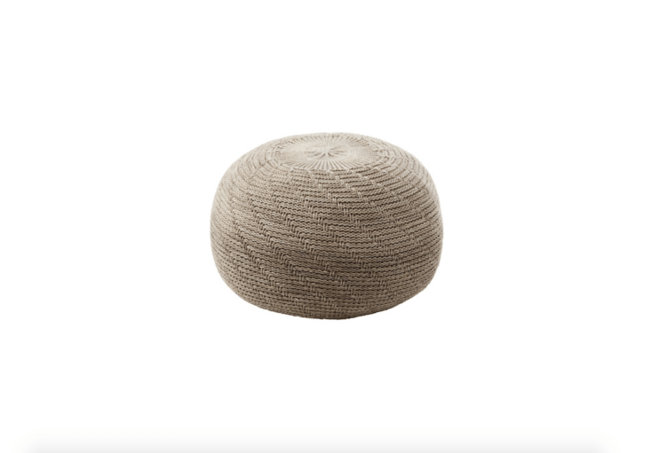 Measuring .75 inches in diameter, a Sandared Knitted Pouffe has a polyurethane foam cushion and a polyester cover; $49.