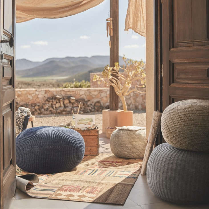 Suitable for use in a covered porch or dry outdoor space, a Sandared knitted pouf has the versatility to be a seat, a footstool, or a floor cushion.