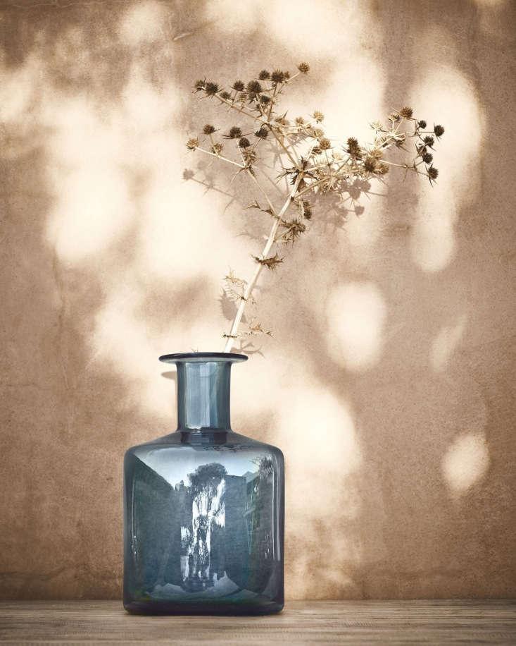 A blue glass Pepparkorn vase, designed by a florist, &#8