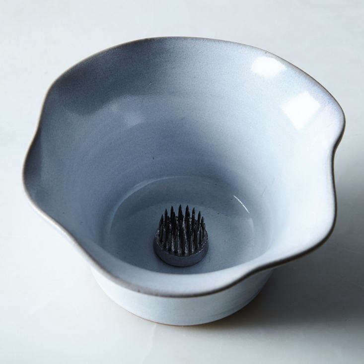 AnIkebana Flower Petal Vase by Moonstar Pottery is available in white (shown) and charcoal; $30 at Food5