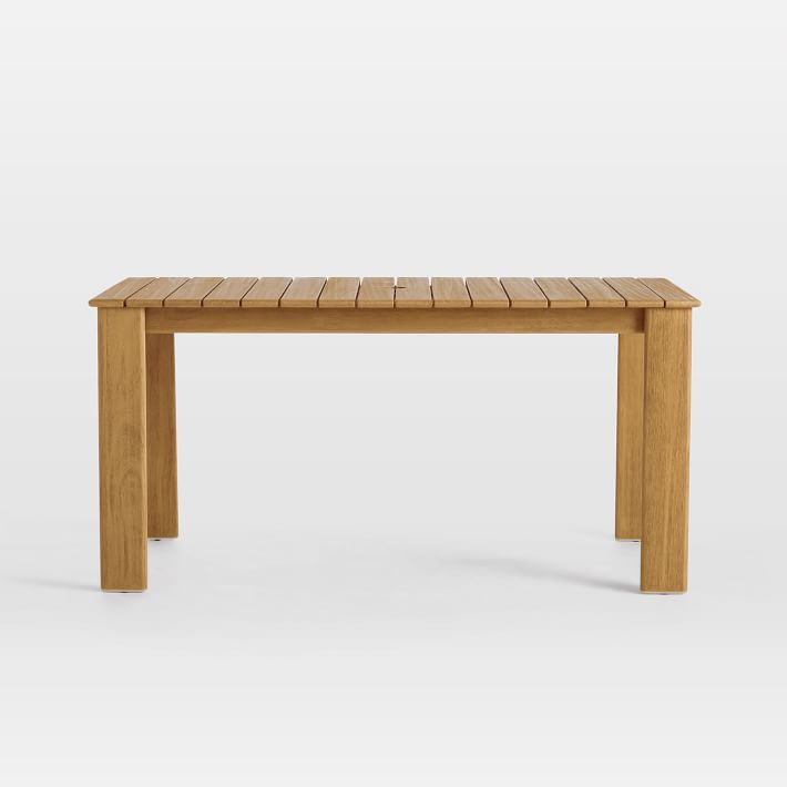 The Playa Outdoor Dining Table, made with FSC-certified mahogany wood, is $599 at West Elm.