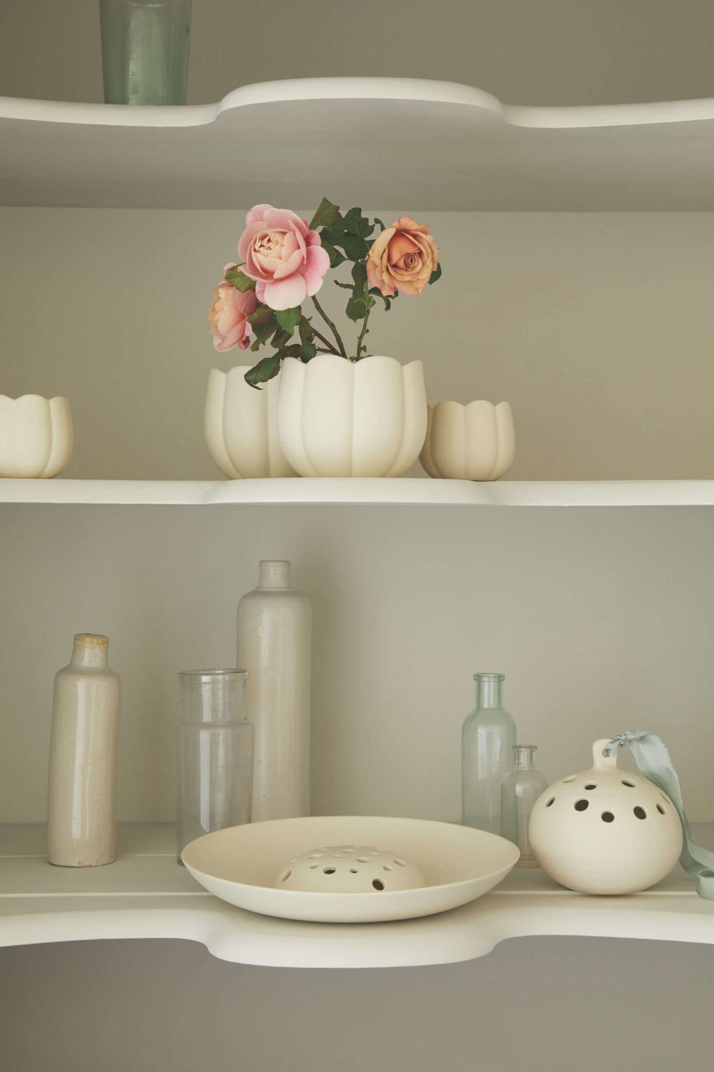 On the lower shelf the Ceramic Flower Frog Bowl, $src=