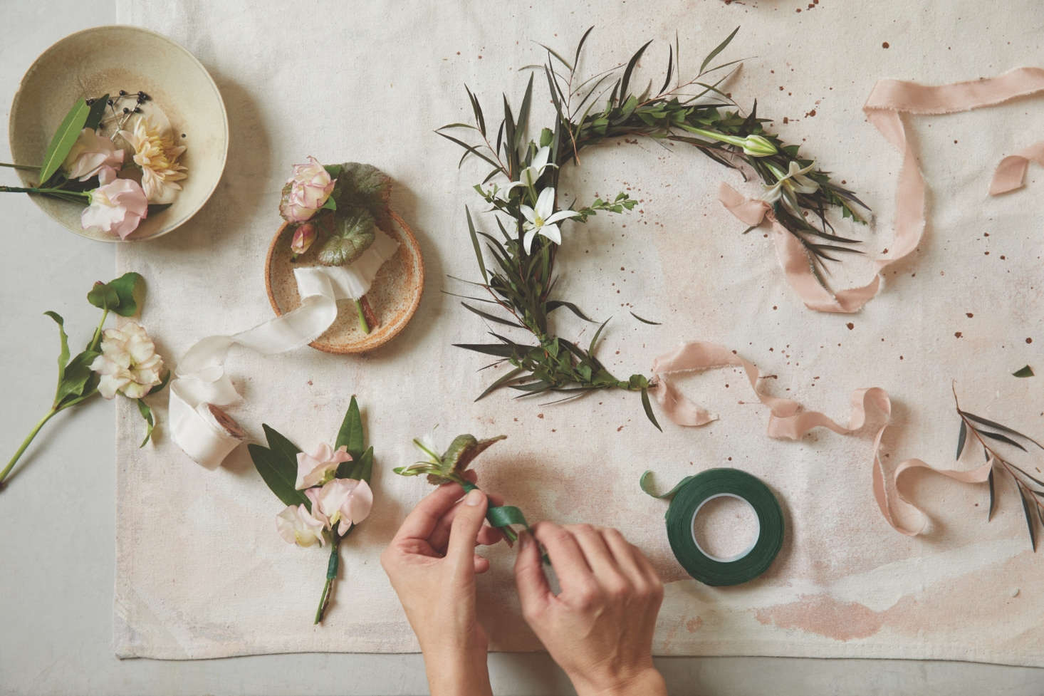 A ribbon-hung wreath in progress. The Floral Society&#8