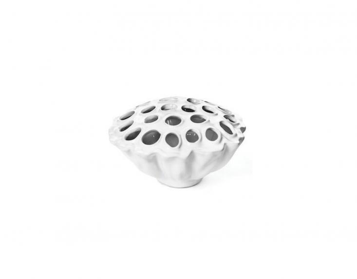 A Round Ceramic Flower Frog VaseRound Ceramic Flower Frog Vase measures 6 by