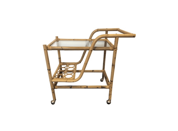 One of a kind, a vintage Bamboo & Rattan Bar Cart has eight bottle-holder slots; \$695 at Chairish.