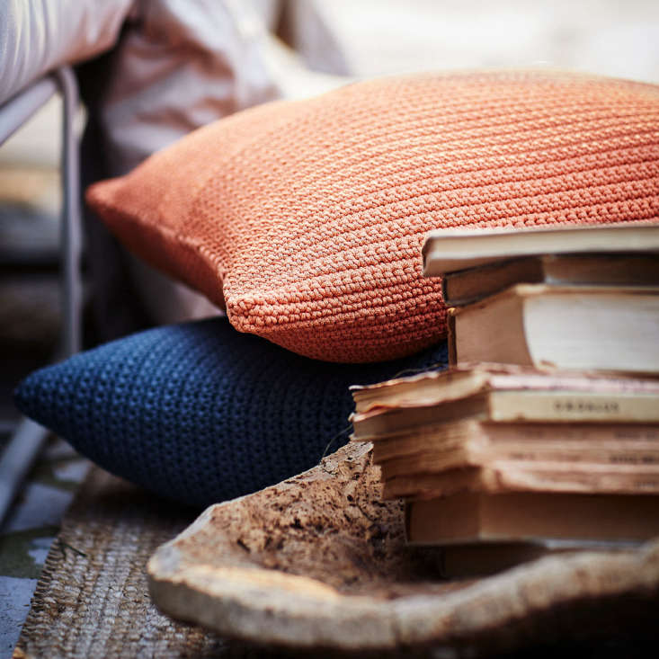 A zippered Sötholmen Cushion Cover has a water-repellent lining and is $.