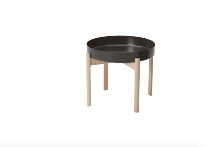 Designed by Hay for Ikea, theYpperlig Coffee Table has a birch base and a dark gray epoxy/polyester-coated steel tray top; \$39.99.