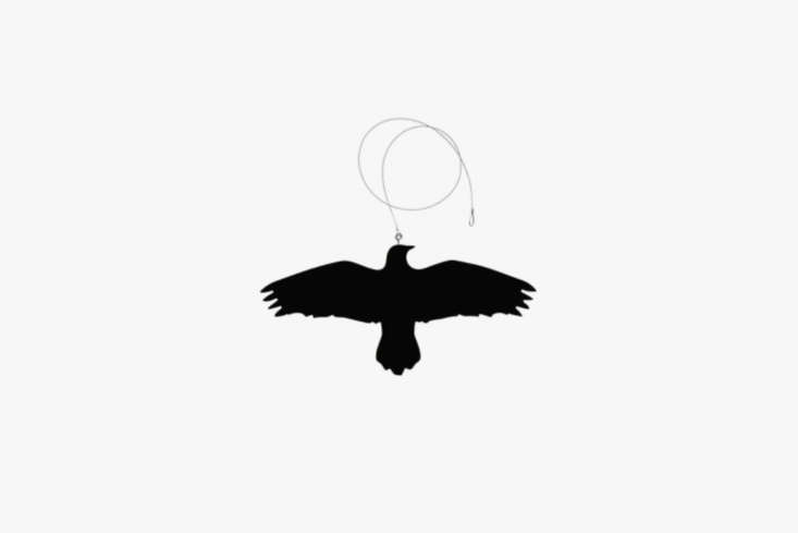 TheIhanna Krummi Bird Hanger with Wire in black wood is similar to the plastic crow hanging from the terrace roof; $45 at Tiina the Store.