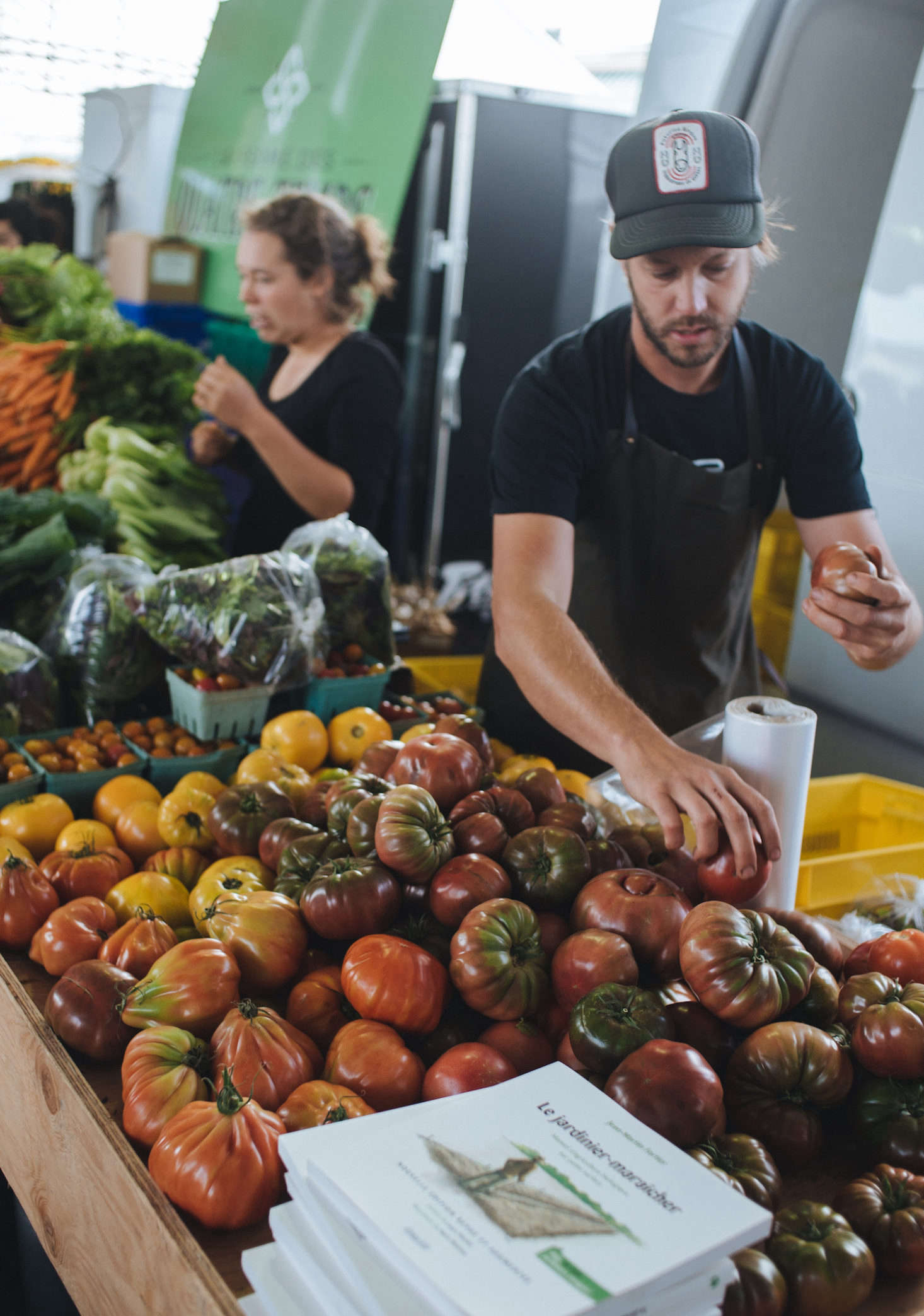 Fortier sells heirloom tomatoes at the market stand.