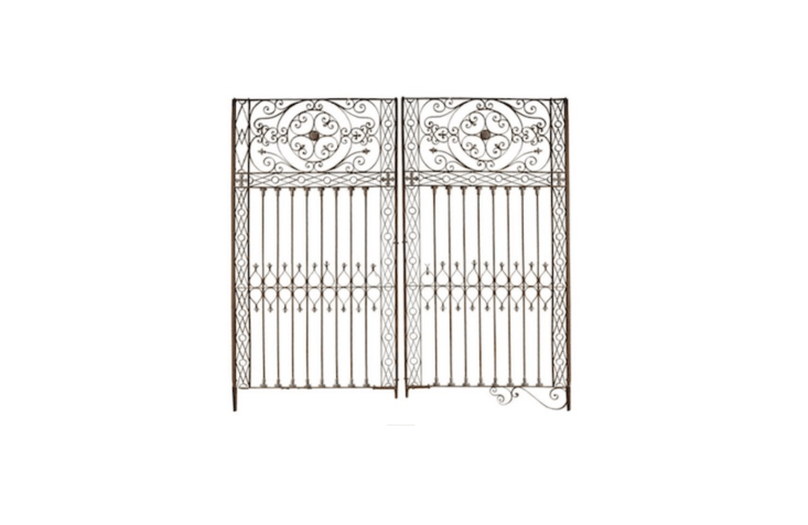 An ornate, early th-century Argentine Wrought Iron Gate is loading=