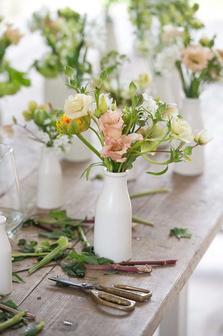 In Craddock&#8\2\17;s studio, &#8\2\20;petite milk bottles, once loved fragrance bottles and old jam jars make great use for smaller stems and off-cuts from larger arrangements.&#8\2\2\1;