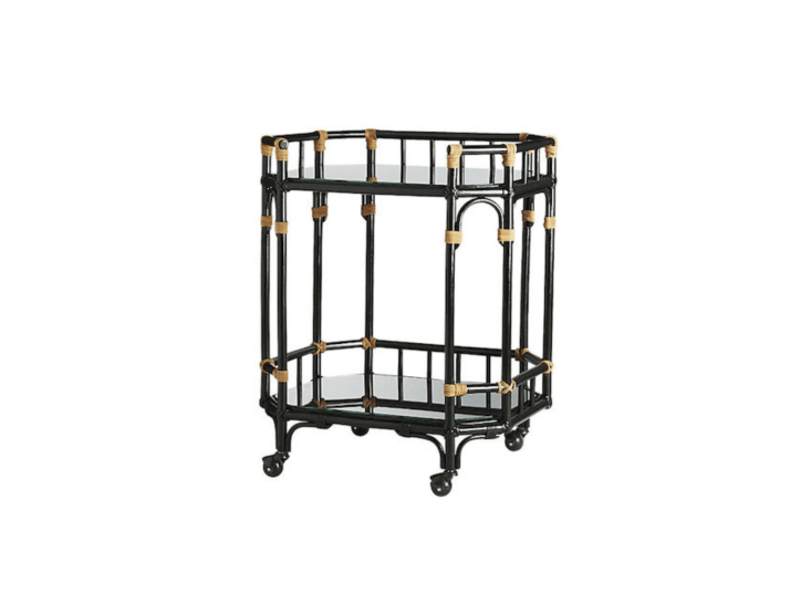 Designed to evoke vintage glamour, anArabella Bar Cart made of black rattan and brown leather belongs in a covered porch or sunroom where it will be protected from the elements; \$399 from CB\2.
