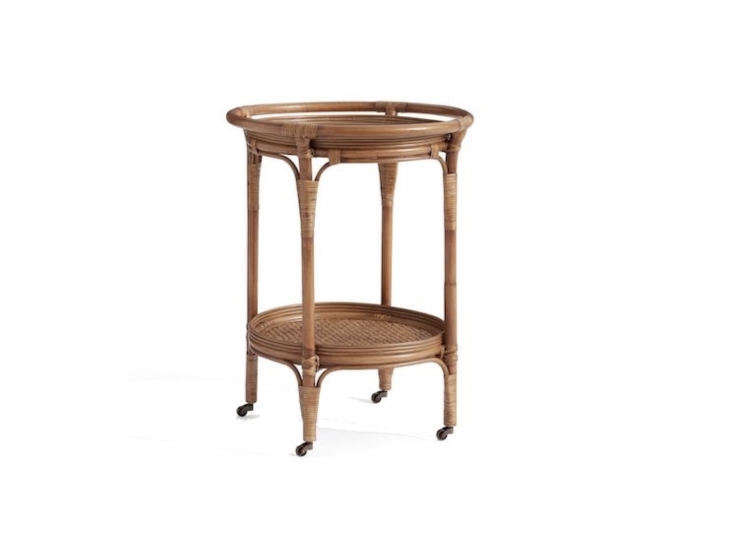 A miniature rattanKali Bar Cart is \23 inches in diameter and has a tempered glass insert on the top shelf; \$399 from Pottery Barn.
