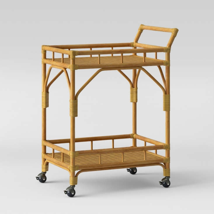 A lacquered rubberwood Cassia Rattan Bar Cart on casters is \$\149.99 from Target.