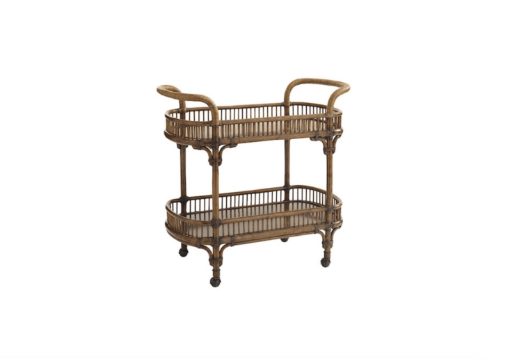 With &#8\2\20;a frame built from wood and cocoa shell veneer shelves, and adorned in rattan wrapped handles,&#8\2\2\1; a Veranda Bar Cart from the Tommy Bahama Bali Hai Collection is \$\1,679.