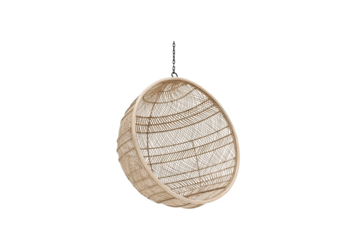 Designed for use in a sunroom or covered porch, a Bohemian Rattan Hanging Bowl Chair needs a spot where it can &#8\2\20;avoid rain, frost, and heat from direct sunlight.&#8\2\2\1; It is €679 from WOO Design.