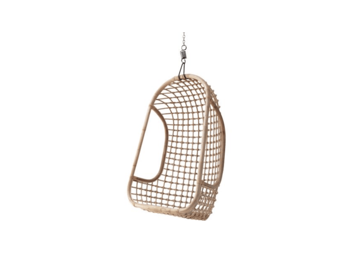 A Rattan Hanging Chair bt HK Living is available in white, black, or natural as shown. It is €\209 from WOO Design.