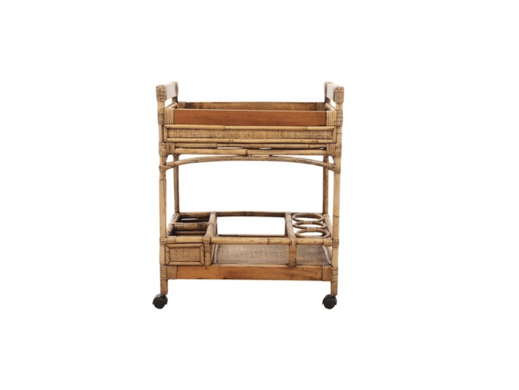A vintageBamboo & Rattan Bar Cart has a maple frame, two shelves, and three bent bamboo bottle holders; \$8\25 on Chairish.