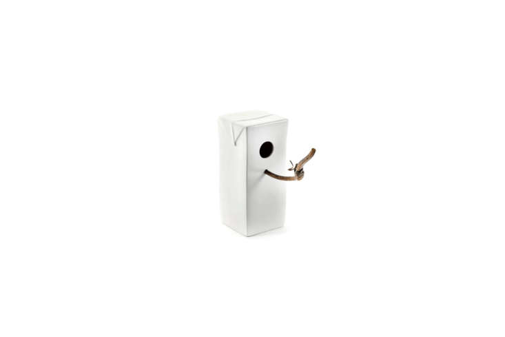 A few of the Serax White Ceramic Birdhouses line the garden wall. They&#8