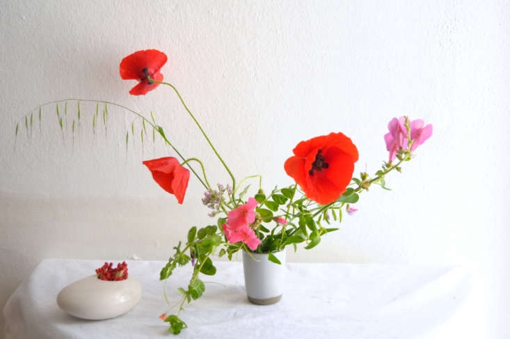 Poppies bring high drama to a vase, so they are best used as a focal flower.