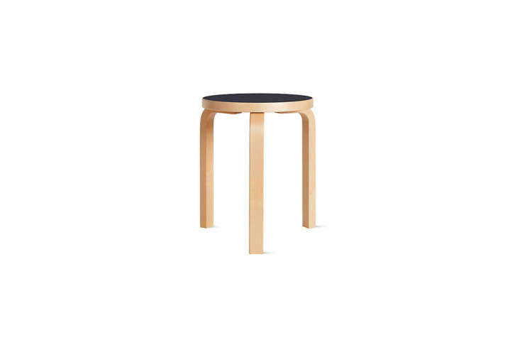 Nightstand, seating, side table—the question is what can&#8\2\17;t theAlvar Aalto 60 Stool with a black linoleum top do? (It is \$\275 at Design Within Reach.)
