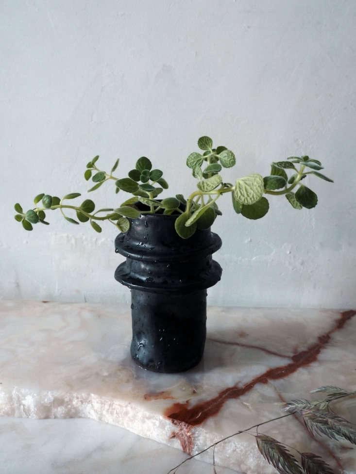 ACrushed Van vase with a gunmetal glaze is \$80.