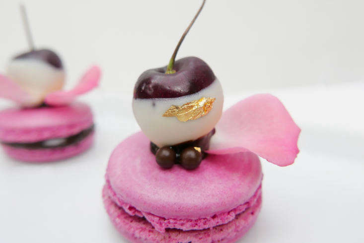 Kristel says her Italian-style macaroons are the trickiest item in her repertoire—made even more difficult with a chocolate-dipped and gilded cherry balanced on top.