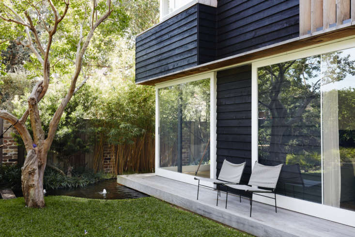 A narrow back deck serves as a step to the garden, and a perch for chairs when entertaining. It&#8