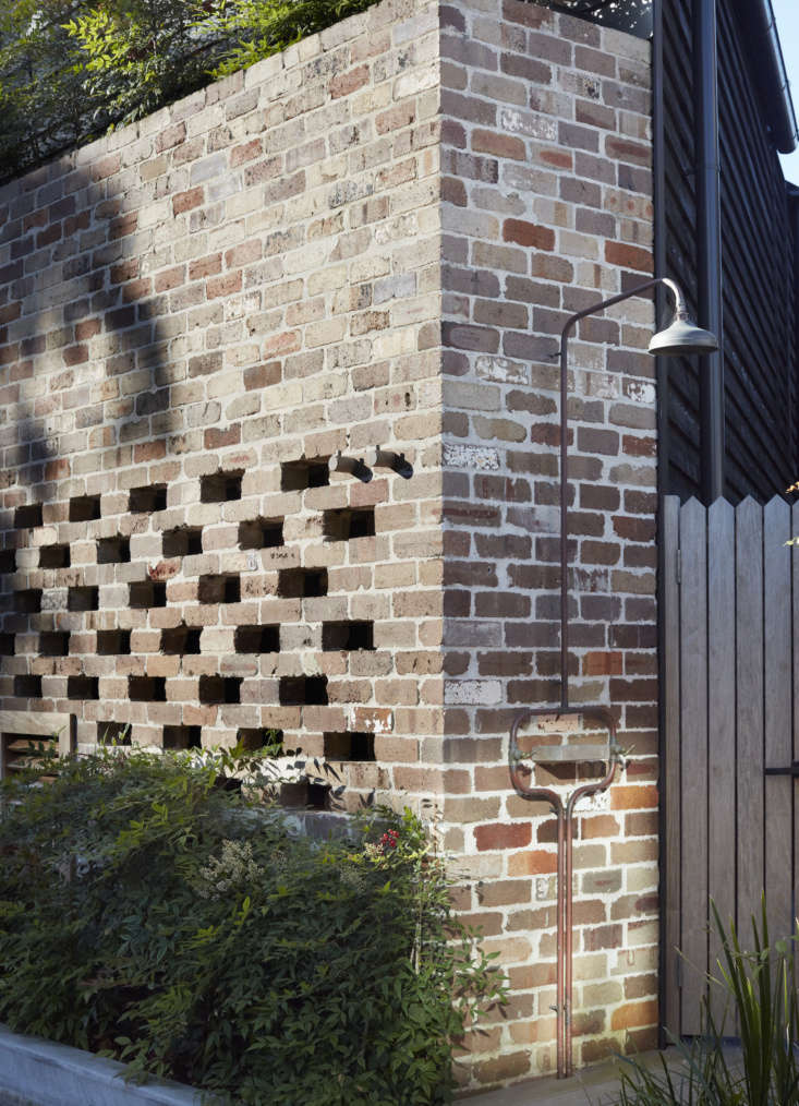 Part of the house, including a corner with an outdoor rinsing shower, is made of brick reclaimed from building demolitions throughout Australia.