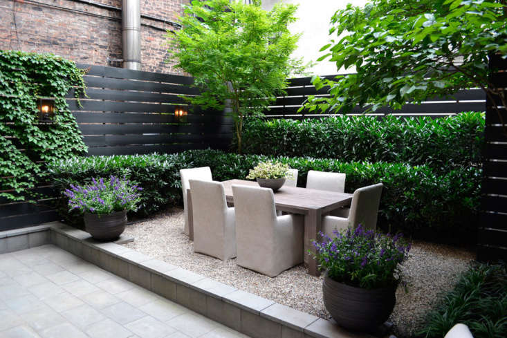 In a small courtyard garden in Manhattan&#8\2\17;s East Village, designed by Gardenista Architect/Designer Directory member Harrison Green, fence-mounted lanterns create a candlelight effect at dusk.