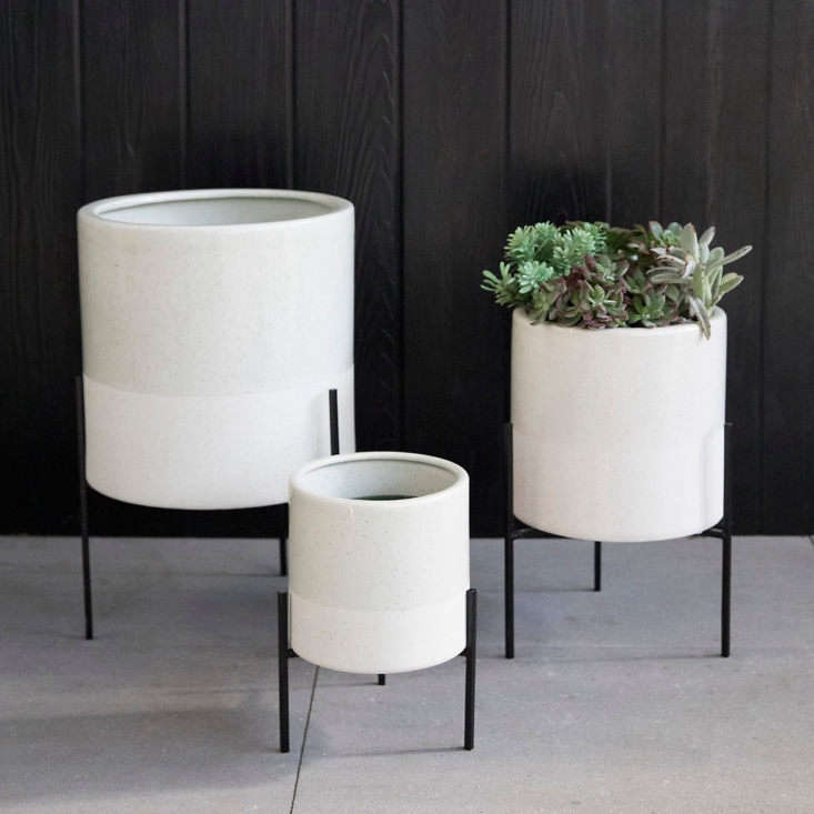 A Ceramic Planter & Metal Stand is available in three sizes (at diameters from 7. to loading=