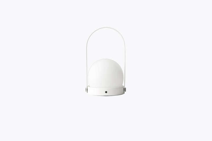 Designed by Norm Architects for Menu, the Carrie Portable LED Lantern comes in a white or black powder-coated-steel housing and an opal glass diffuser; $3.97 at Menu.