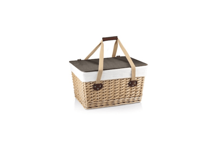 With a woven willow frame and a removable lid made of composite wood that doubles as a tray, aCanasta Basket has a washable lining and measures \16.5 by \1\1.3 by 9.8 inches. It is \$55.95 at Picnic Time.