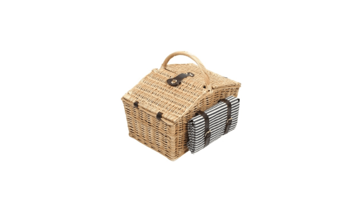 ASomerley Picnic Hamper with a striped blanket to match the basket&#8\2\17;s &#8\2\20;midnight blue and white striped lining&#8\2\2\1; comes with plates, glasses, and cutlery (plus salt and pepper shakers) to serve four; £99.99 from Amazon UK.