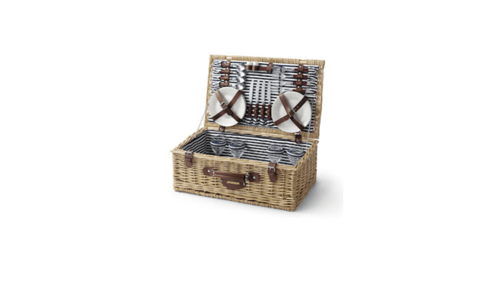 A flat-liddedEnglish Style Picnic Basket with a striped navy lining comes with &#8\2\20;lunch service for four—including plates, glasses, and flatware&#8\2\2\1; and is \$99 from Land&#8\2\17;s End.