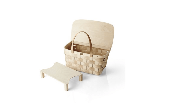A Leather-Handled Picnic Basket New England white ash by Peterboro Baskets comes with a serving tray that can be stored inside; \$69.95 at Crate & Barrel.