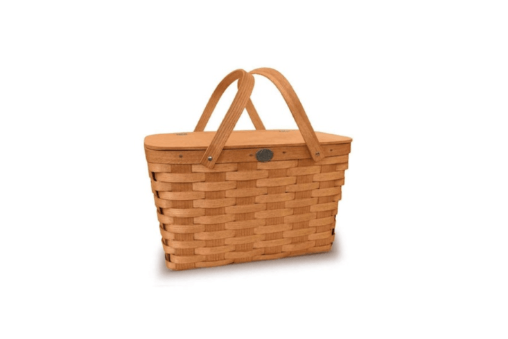 From Peterboro Baskets and made of woven strips of white Appalachian ash, a classic Picnic Basket has a solid wooden lid and measures \18 inches long by \1\2 inches wide by \10 inches high; \$79 at Boston General Store.