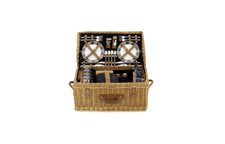 A suitcase-style wovenWicker Picnic Basket &#8\2\20;is thoughtfully designed for gracious outdoor dining&#8\2\2\1; with tableware to serve four, including porcelain plates and handblown wine glasses. With leather handles and a cotton corduroy lining, it is \$\279.96 at Williams Sonoma.