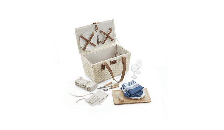 AnOutfitted Wooden Picnic Basket has &#8\2\20;chunky basketweave and sturdy leather handles&#8\2\2\1; and includes tableware for four (&#8\2\20;ceramic plates, wine glasses, cotton napkins, and wood-handled flatware, each set secured in its own wrap&#8\2\2\1;). Plus a cutting board and a corkscrew. It&#8\2\17;s \$\199.95 at Crate & Barrel.