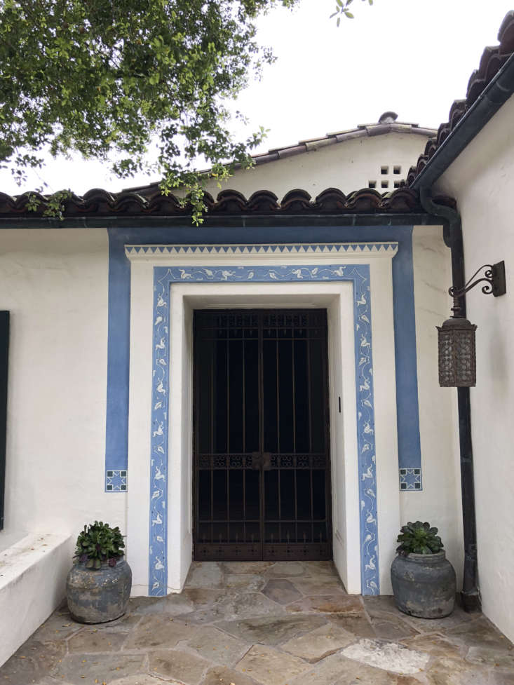The entryway, with the original tile work and flagstone path preserved. Sosa and Gonzalez &#8