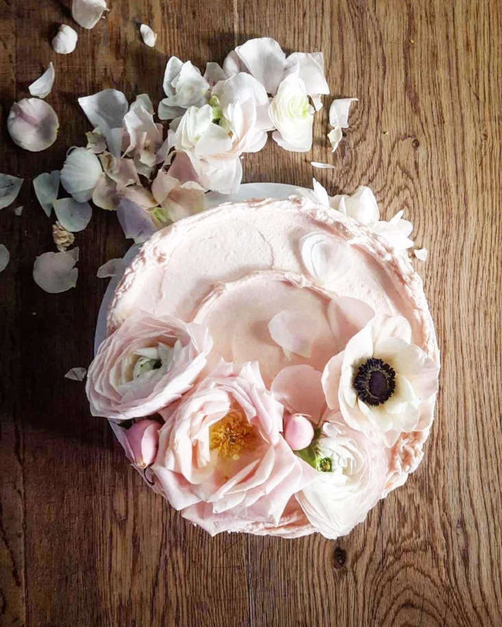 We can report with authority that this is not what the royal wedding cake will look like. This is a rhubarb birthday cake from Violet Cakes, decorated with pink roses and white anemones.