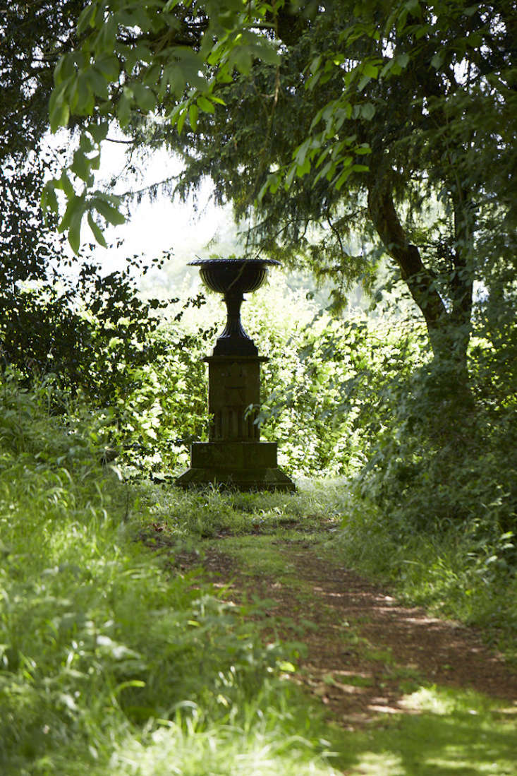 Use larger pieces such as an urn on a plinth or taller statuary to lead the eye through to views along paths.