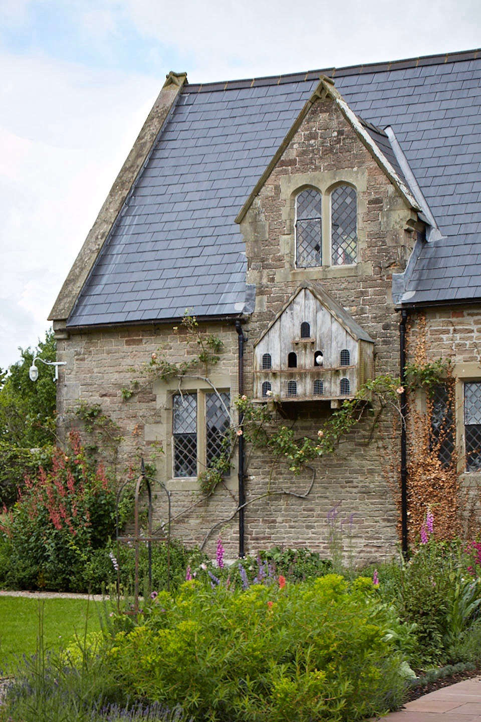 For many gardeners a timber dovecote added to the gable end of a country house or freestanding in a lush orchard or meadow is a bucolic symbol of a time gone by.