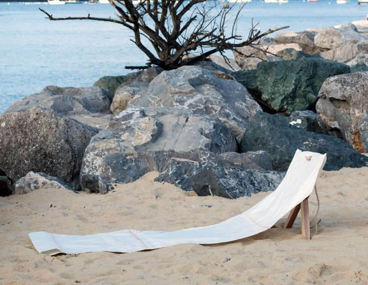 The ingenious Fortuna design, \$\290, has a wooden support that sinks into the sand. When not in use, the sailcloth rolls up into a rope-tied package with the legs stored in the sleeve at the bottom.